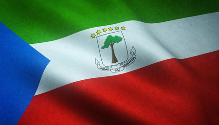 Realistic flag of Equatorial Guinea with highly detailed fabric texture. Stock Photo
