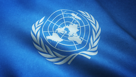 Realistic flag of United Nations waving with highly detailed fabric texture. Stock Photo