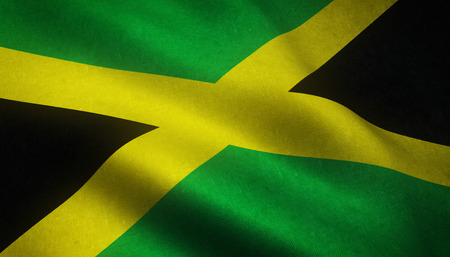 Realistic flag of Jamaica waving with highly detailed fabric texture. Stock Photo
