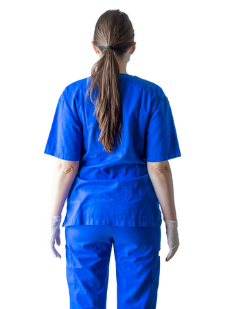 Portrait of an unknown young doctor in blue medical uniform with hands in sterilized surgical gloves. Caucasian female model isolated over white background.