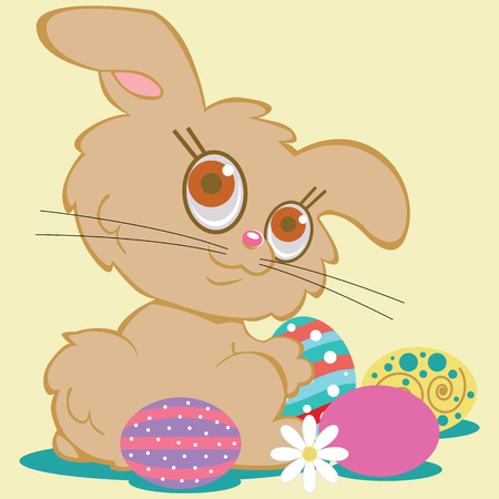 A cute tan bunny rabbit is surrounded by colorful decorated Easter eggs. Looking back over one shoulder with a satisfied expression and big brown eyes.