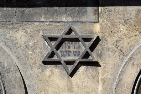 jewish star: symbol of jewish star of david on the front on old building in kazimierz-district of krakow in poland