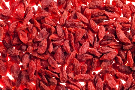 lycium: a lot of of red goji berry isolated on white background close up