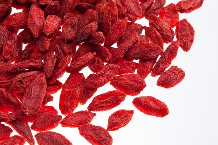 a lot of of red goji berry isolated on white background close up photo