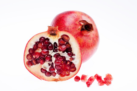sectioned: sectioned pomegranate isolated on white background