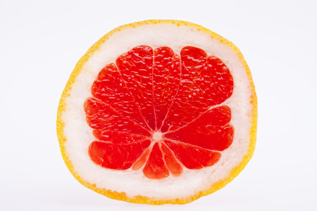 sectioned fruit of red grapefruit isolated on white background Stock Photo