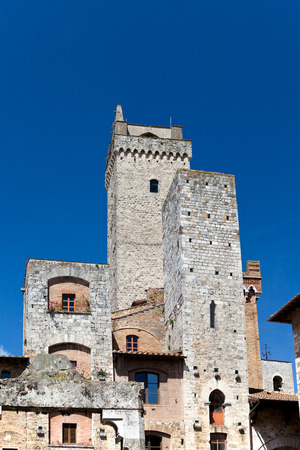 towers of the Ardinghelli family on Piazza della Cisterna in San Gimignano in tuscany in italy