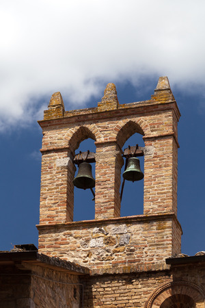 view on some of famous tower with bells in San Gimignano in Toscany in italy photo
