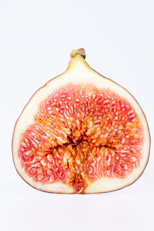 sectioned: fruit of sectioned fresh fig isolated on white background
