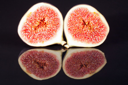 sectioned: fruits of sectioned fresh figs isolated on black  background