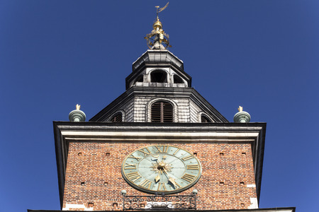 polska monument: clock on the town hall tower on main market sguare in Cracow, Poland