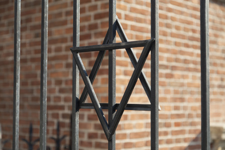 synagogues: Star of David on metal fence of the Old Synagogue in jewish Kazimierz district of Cracow on Broad street in Poland