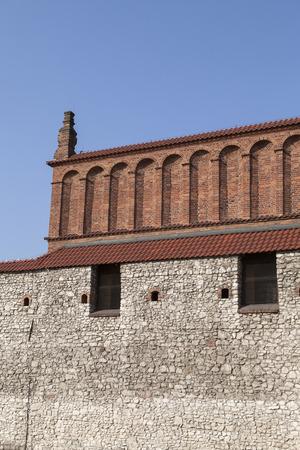 kuzmir: old synagogue with  stone wall in jewish district of krakow - kazimierz on szeroka street in poland Stock Photo
