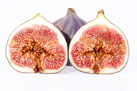 some fruits of fresh figs isolated on white background, close up Stock Photo