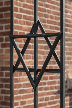 szeroka: Star of David on metal fence of Old Synagogue in jewish district of Cracow - Kazimierz on Szeroka street in Poland Stock Photo