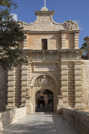 taxi famous building: City Gate to the medieval town Mdina, Malta , Europe