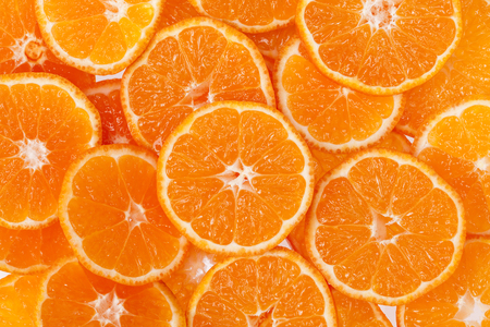 clementine: background of slices of clementine fruit. Stock Photo
