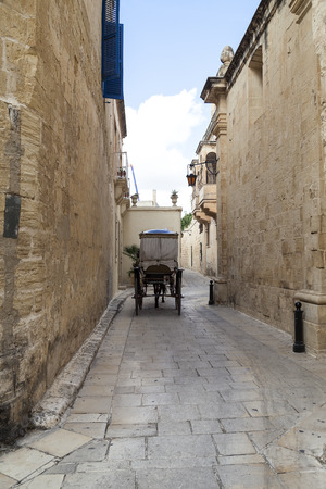 taxi famous building: Typical narrow street with cab  in the medieval town Mdina, Malta, Europe