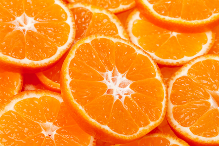 clementine fruit: background of slices of clementine fruit, close up.