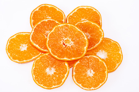 clementine fruit: some slices of clementine fruit isolated on white background.