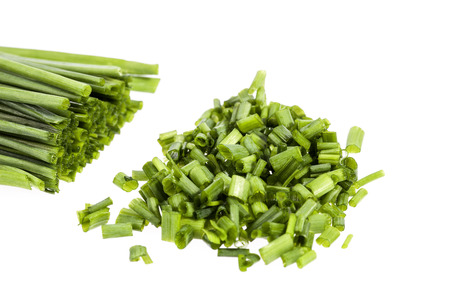 hacked: bunch of fresh chives isolated on white background.