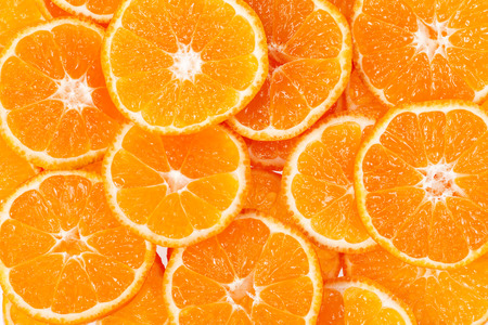 clementine fruit: background of slices of clementine fruit. Stock Photo