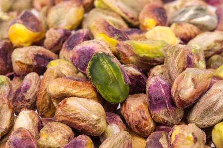 pistachios: background of fruits of pistachios, close up. Stock Photo