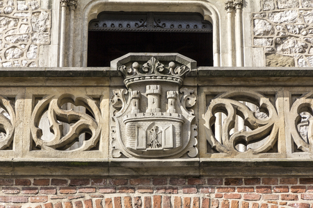 cracow: Coat of arms of Cracow- stone carving on Florian Gate in Cracow, Poland.