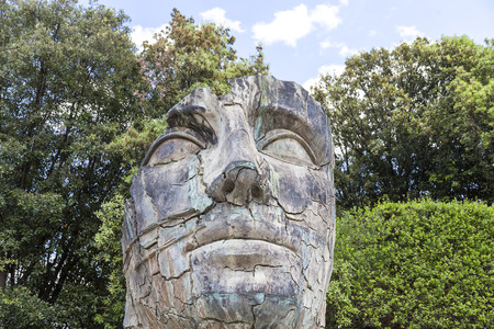 igor: FLORENCE, ITALY - MAY 18, 2014 : Sculpture by Igor Mitoraj in the Boboli Gardens in Florence, Italy. Works of Polish sculptor Igor Mitoraj, often gigantic size, stand in representative sections of many cities in the world. Stock Photo