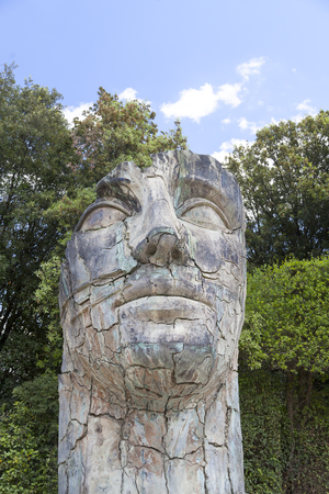 igor: FLORENCE, ITALY - MAY 18, 2014 : Sculpture by Igor Mitoraj in the Boboli Gardens in Florence, Italy. Works of Polish sculptor Igor Mitoraj, often gigantic size, stand in representative sections of many cities in the world. Editorial