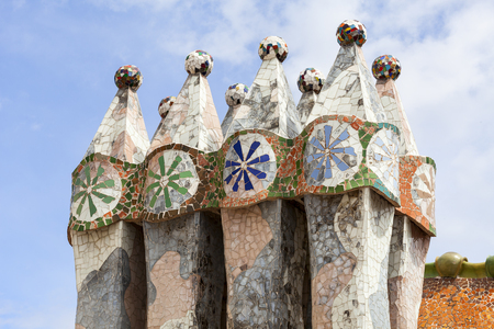 housetop: Barcelona, Spain - May 11,2016 : Casa Batllo,  housetop , chimneys with ceramic mosaic. Building  redesigned in 1904 by Gaudi located in the center of Barcelona, it  is on the UNESCO World Heritage Site. Editorial