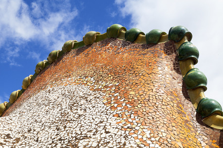 housetop: Barcelona, Spain - May 11,2016 : Casa Batllo,  housetop , details with ceramic mosaic. Building  redesigned in 1904 by Gaudi located in the center of Barcelona