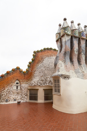 housetop: Barcelona, Spain - May 11,2016 : Casa Batllo,  housetop , chimneys with ceramic mosaic. Building  redesigned in 1904 by Gaudi located in the center of Barcelona,