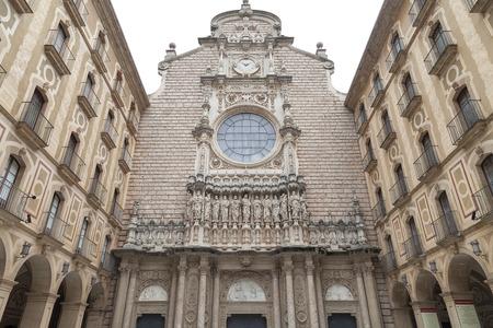 virgin of montserrat: MONTSERRAT, SPAIN - MAY 10, 2016 : Facade of Santa Maria de Montserrat Abbey, Catalonia.Santa Maria de Montserrat  is a Benedictine abbey located on the mountain of Montserrat,  known for the cult statue of Virgin Mary.
