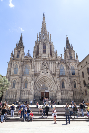 barcelona cathedral: BARCELONA, SPAIN -MAY 11, 2016. Tourists on the square in front of Barcelona Cathedral. It is the Gothic cathedral constructed from the 13th to 15th centuries. Editorial