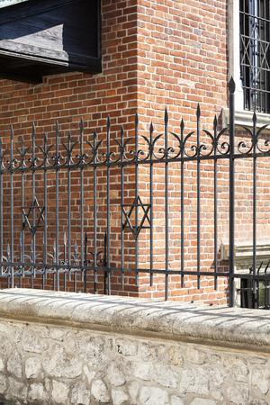 kuzmir: Star of David on metal fence of Old Synagogue in jewish district of Krakow - Kazimierz on Szeroka street in Poland