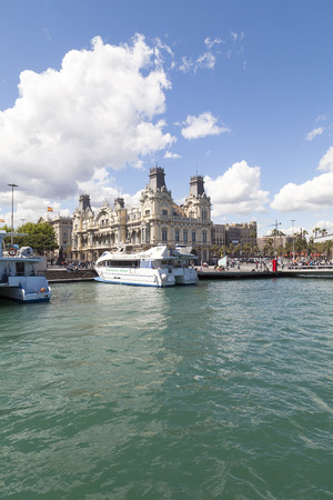11 year old: BARCELONA, SPAIN - MAY 11, 2016 : View  from the sea on Port Vell and Barcelonas old Customs building, Barcelona, Spain.It  is a waterfront harbor in city and part of the Port of Barcelona.16 million people visit the complex each year