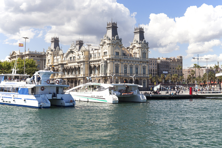 BARCELONA, SPAIN - MAY 11, 2016 : View  from the sea on Port Vell and Barcelonas old Customs building, Barcelona, Spain.It  is a waterfront harbor in city and part of the Port of Barcelona.16 million people visit the complex each year
