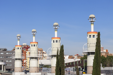 espanya: BARCELONA, SPAIN - MAY 12, 2016 : Towers in Espanya Industrial Park.It is located near Sants train station, an area of 4.6 hectares is ideal for family relaxation. A special highlight is a giant dragon - slide for children.