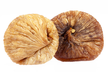 some fruits of dried fig isolated on white background.