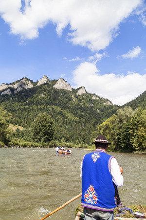 rafter: SZCZAWNICA, POLAND - AUGUST 14, 2016 : Dunajec River Gorge .View from boat rafting. 18-kilometer  route runs through the Pieniny Mountains to Szczawnica, National Park,  by river on the border between Poland and Slovakia.