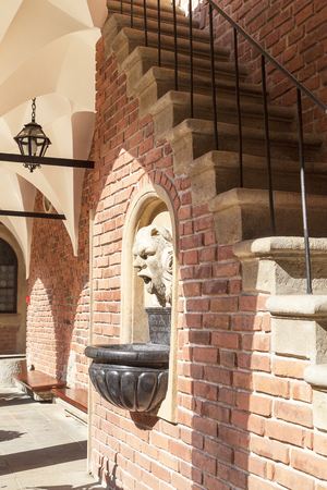 collegium: KRAKOW, POLAND - JUNE 26, 2016 :Courtyard  of Collegium Maius, Old Town. It  is the Jagiellonian Universitys oldest building,dating back to the 14th century. Stock Photo