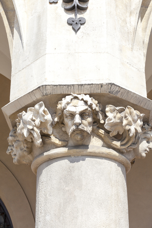 main market: Decorative head of the column, Cloth Hall ( Sukiennice),Main Market Square, Krakow, Poland .