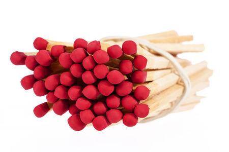 red heads: Heap of matches with red heads isolated on white background, close up Stock Photo