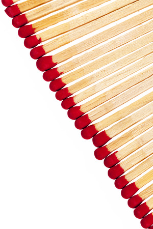 red heads: composition of matches with red heads isolated on white background, close up Stock Photo