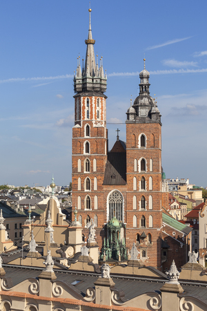 marys: Towers of St. Marys Basilica ( Mariacki) on Main Market Square, Krakow, Poland