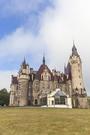 MOSZNA, POLAND - OCTOBER  07, 2016 : View on 17th century  Moszna Castle on a sunny day.It  is a historic castle and residence located in a small village , one of the best known monuments in the western part of Upper Silesia.