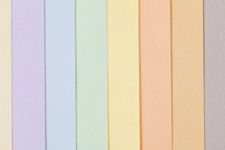 Background of pastel colors paper , parallel vertical stripes, place for text