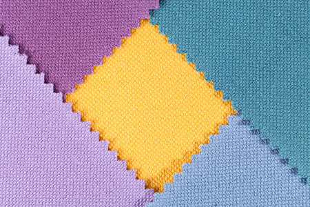 splice: Composition of colored pieces of serrated cotton fabric. Stock Photo