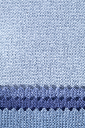 Composition of colored stripes of serrated cotton fabric.place for text